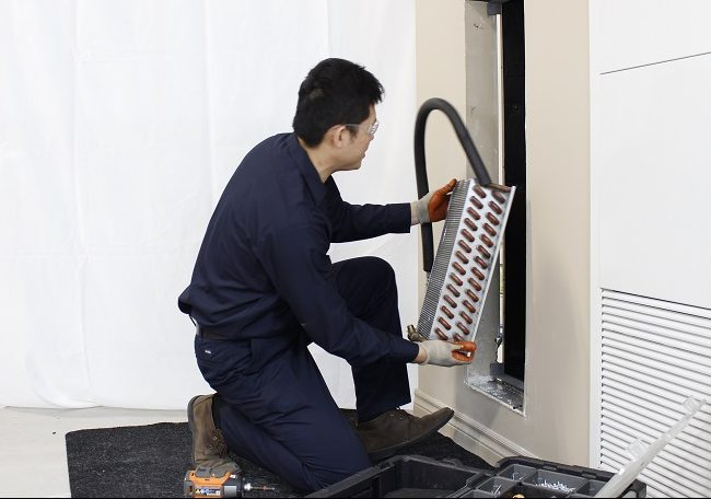 Fan Coil Installation - Technician Installing Hydronic Coil